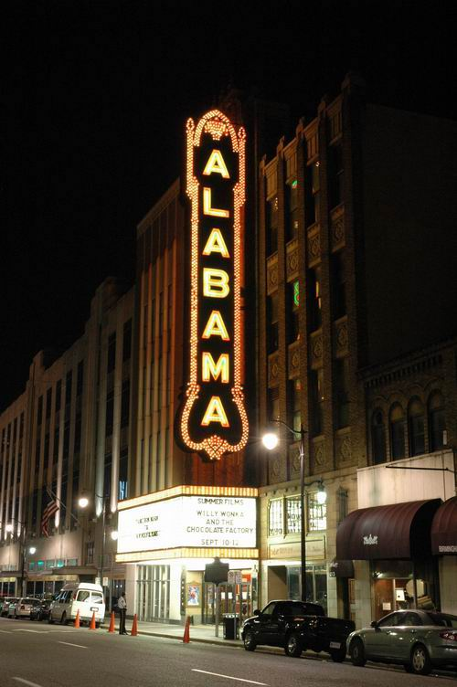 Alabama Theatre exterior and marquee at night.
