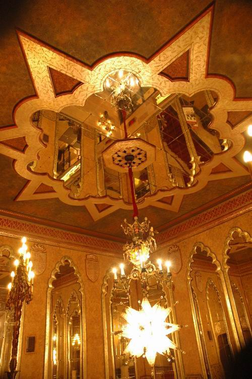 The mirrored ceiling and chandelier in the front lobby of the Alabama Theatre.