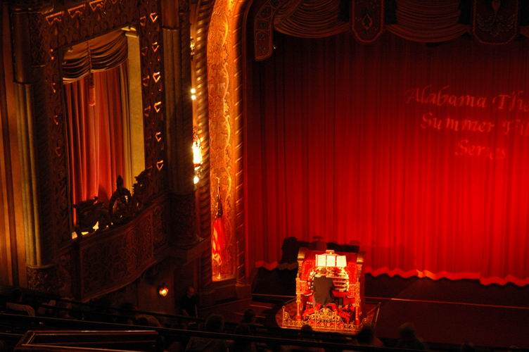 Cecil Whitmire plays the Wurlitzer before a film, as seen from the balcony.